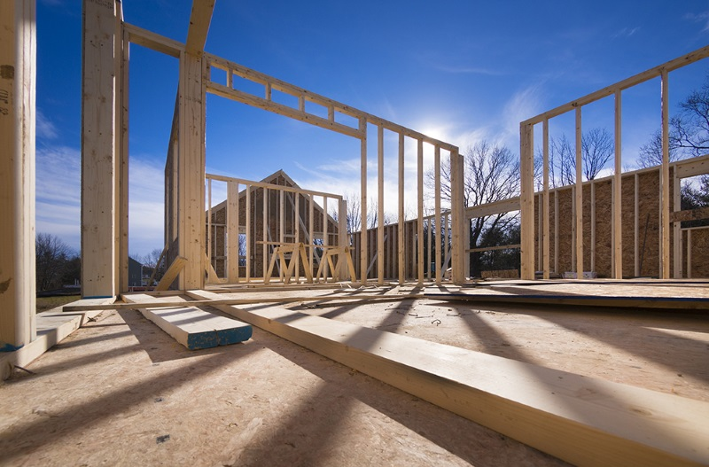 Construction site of a new house being built showing wood beams.